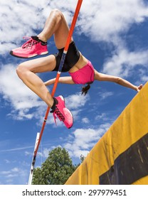 young woman in highjump in track and field
