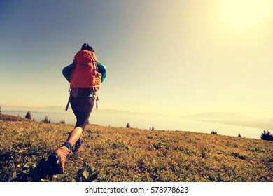 young woman hiker hiking in beautiful mountains