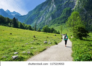Young woman Hikers on the trail in the Scenic summer landscape view in the Alps, National park Berchtesgaden Land, Bavaria, Germany.