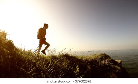 young woman hiking on seaside mountain trail