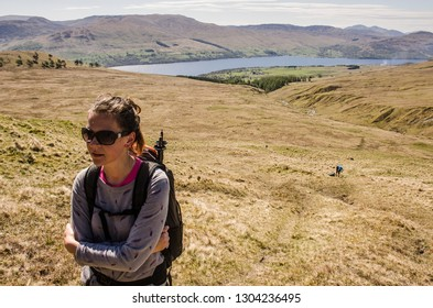 Young woman hiking in Scotland
