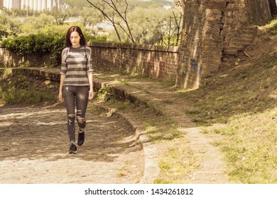 A Young woman hiking in summer