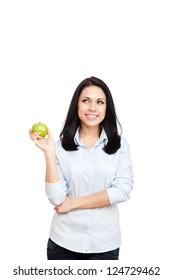 young woman hold green fresh apple, female happy smile think looking up side to empty copy space, isolated on white background natural organic food fruit concept