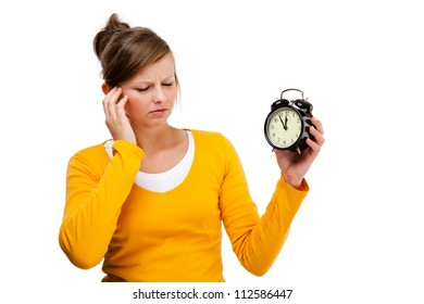 Young woman holding alarm-clock isolated on white