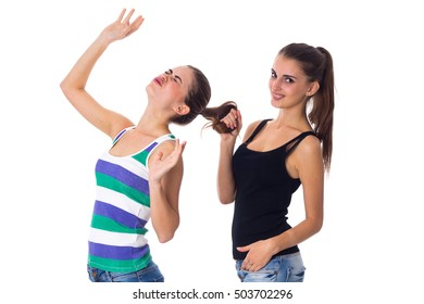 Young woman holding another woman's hair