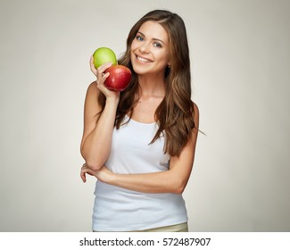 young woman holding apples. red and green. long hair. smiling girl.