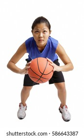 Young woman holding basketball, aiming for a hot