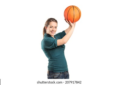 Young woman holding a basketball isolated on white background