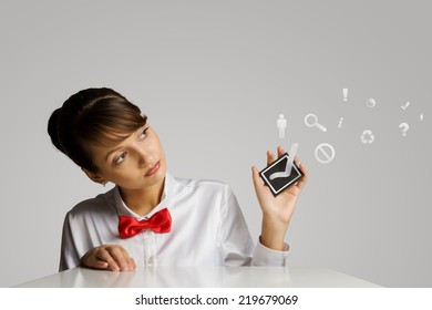 Young woman holding black card with tick