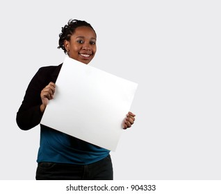 A young woman holding a blank sign.