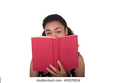 A young woman holding a book isolated on white