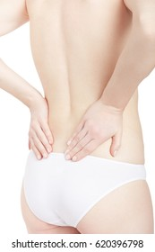 Young woman holding both hands on lower part for back pain, backache isolated on white, clipping path