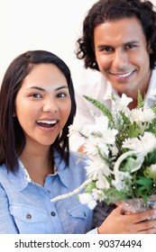 Young woman holding the bouquet she got from her boyfriend