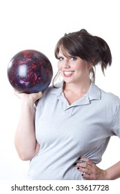 Young woman holding a bowling ball; isolated on a white background.