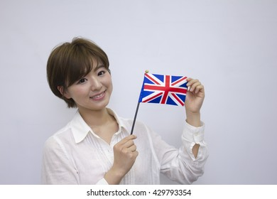 Young woman holding British flag