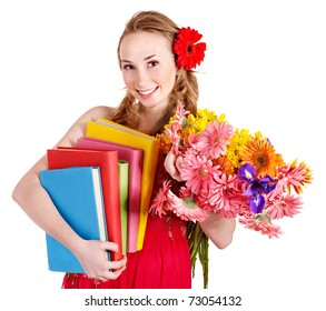 Young woman holding bunch of flowers and books.