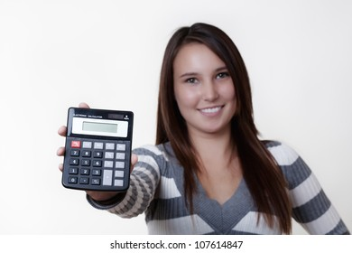 young woman holding up a calculator showing you what adds up