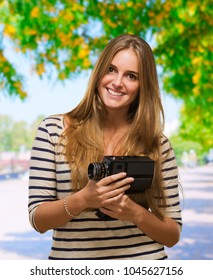 Young Woman Holding A Camera, outdoor