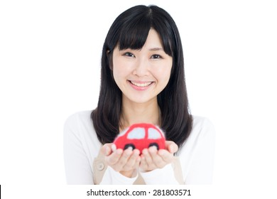 young woman holding car toy isolated on white background