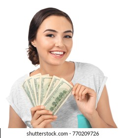 Young woman holding cash on white background