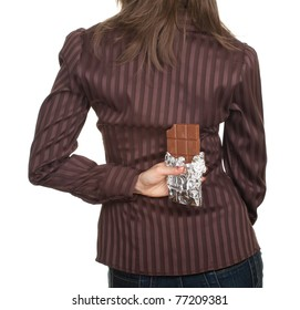young woman holding chocolate after her back