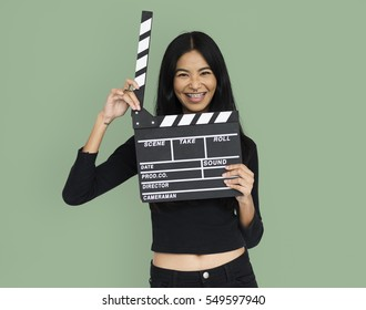 Young woman in holding clapperboard