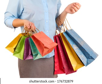 Young woman holding colorful shopping bags in  her hand, isolated on white