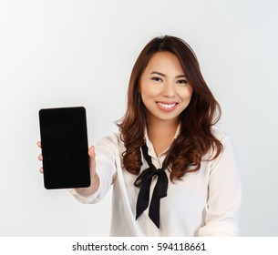 young woman holding a computer tablet showing the screen