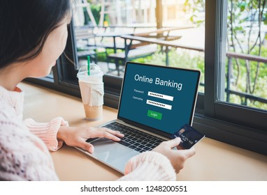 Young woman holding credit card and using online banking on laptop computer.Financial and investment and internet payments shopping network.
