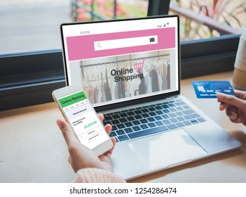 Young woman holding credit card and using online banking on smartphone.Financial and investment and internet payments shopping network.