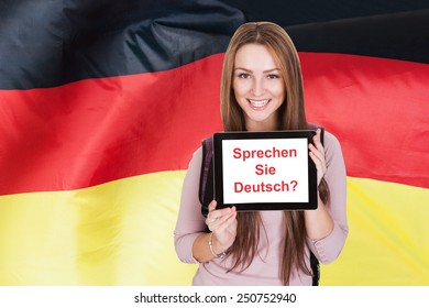 Young Woman Holding Digital Tablet Asking Do You Speak German