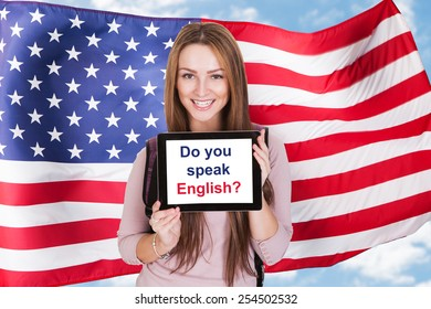Young Woman Holding Digital Tablet Asking Do You Speak English In Front Of Usa Flag