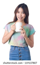Young woman holding and  drinking beverage on white background