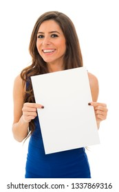 Young woman holding empty board