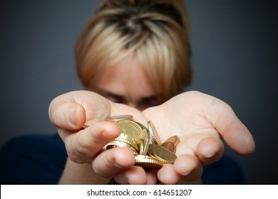 Young woman holding euro coins