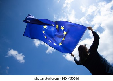 Young woman holding European Union flag. Voting, election concept.