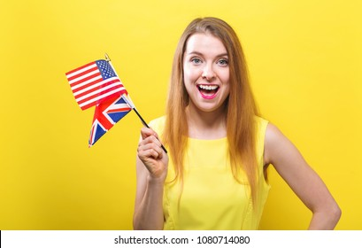 Young woman holding the flags of English speaking countries
