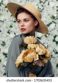 young woman holding a flower in her hands
