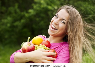 Young woman holding fruits and vegetables