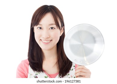Young woman holding frying pan, isolated on white background