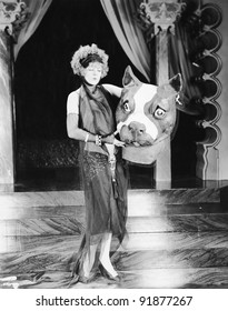 Young woman holding a giant dogs head