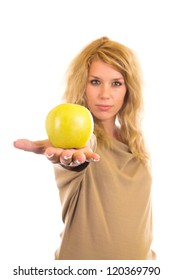 Young woman holding green apple