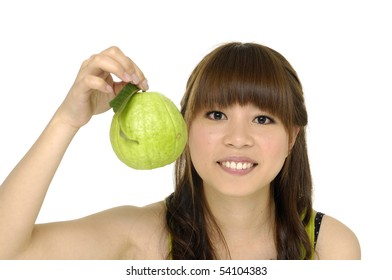 young woman holding guava fruit close up,