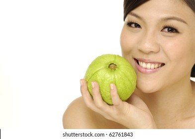 young woman holding guava fruit-close up