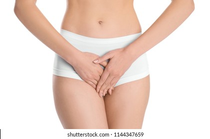 Young woman holding hands near underwear on white background. Gynecology