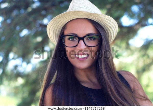 young woman holding hat glasses summer holiday attractive people smiling portrait