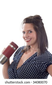 Young woman holding an insulated mug with a beverage; isolated on a white background.
