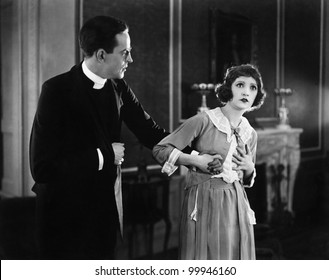 Young woman holding a man's hand and looking surprised