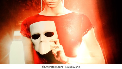 young woman holding mask