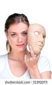 Young woman holding a mask in front of her face, isolated on a white background.